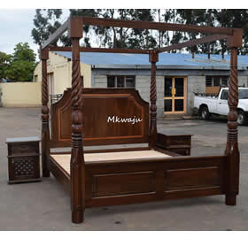 Hard wood 2 poster bed by Mkwaju furniture